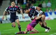 Melbourne Rebels' Cooper Vuna (R) is tackled by a Northern Bulls player during their Super 15 rugby union match in Melbourne, on May 4, 2012. The 2013 Super 15 season kicks off this weekend with two all-Australian ties as players seek to impress national selectors ahead of the looming British and Irish Lions tour Down Under. The Rebels host Western Force in their opener on Friday