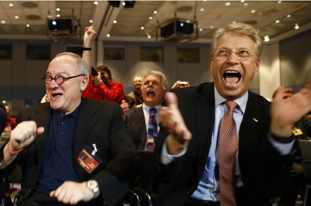 ESA Director General Dordain and ESOC Director General Reiter react after ESA's satellite Rosetta resent a signal to ESOC in Darmstadt
