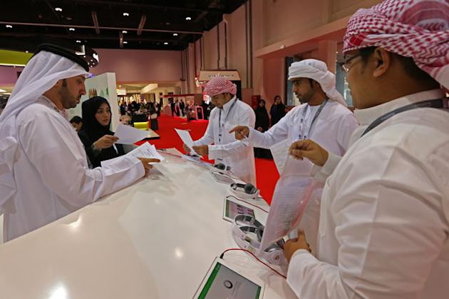 Experts offer guidance to Emirati jobseekers on the opening day of Tawdheef Career Fair 2015 at Abu Dhabi National Exhibition Centre on Monday. — KT photo by Nezar Balout