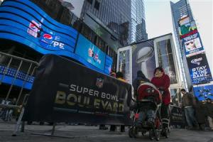 A woman walks through Times Square which has been transformed into Super Bowl Boulevard ahead of Super Bowl XLVIII in New York