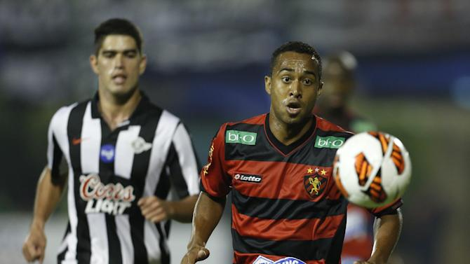 Luis Amarilla, of Paraguay's Libertad, left, fights for the ball with Brazil's Sport Recife's Airton at a Copa Sudamericana soccer game in Asuncion, Paraguay, Wednesday, Sept. 25, 2013