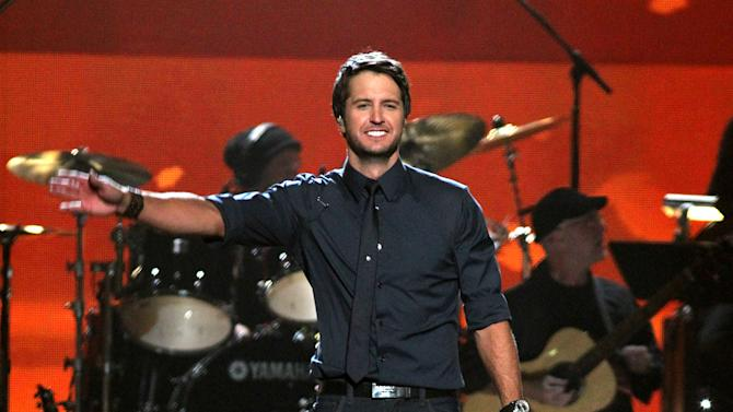 "FILE - In this April 2, 2012 file photo, Luke Bryan performs ""Running with the Night"" at ACM Presents: Lionel Richie and Friends in Concert in Las Vegas. Luke Bryan leads the 2012 American Country Awards nominees with seven nominations; Lady Antebellum and Zac Brown Band each earned six nods; and Eric Church and Taylor Swift garnered five nominations.  The American Country Awards will air live from Mandalay Bay in Las Vegas Monday, Dec. 10, 2012 (8:00-10:00 PM ET live/PT tape-delayed) on FOX.  (AP Photo/Jeff Bottari, File)"