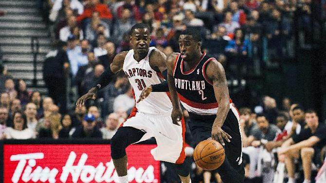 Portland Trail Blazers' Wesley Matthews (2) moves down the court against Toronto Raptors Terrence Ross during an NBA basketball game in Toronto on Sunday, Nov. 17, 2013
