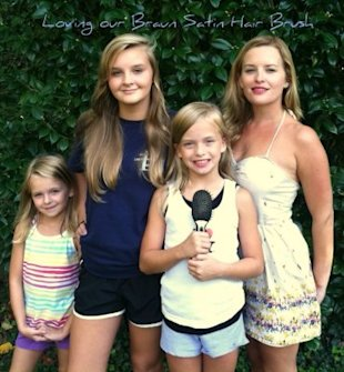 Shine Beauty Guru Apple (far right) and her three daughters are all fans of the Braun hairbrush.