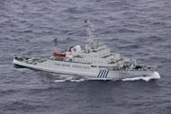 This handout picture taken by the Japan Coast Guard shows a Chinese marine surveillance ship cruising near disputed islands -- known as Senkaku in Japan and Diaoyu in China -- in the East China Sea on December 17, 2012. China has transferred two destroyers and nine other ex-navy vessels to its maritime surveillance fleet, according to one of China's major news portals