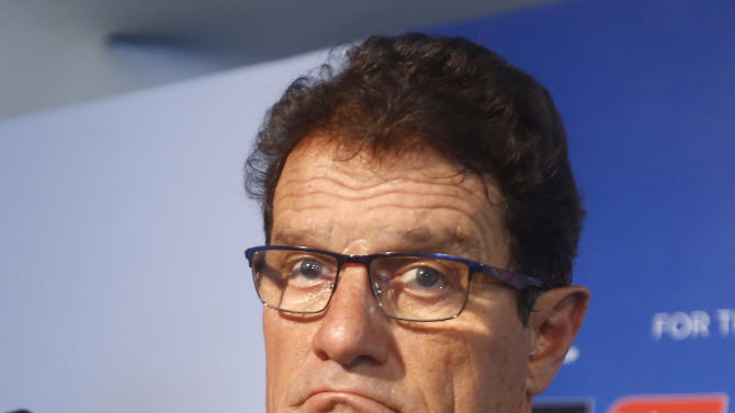 Russia head coach Fabio Capello from Italy answers questions after the draw ceremony for the 2014 soccer World Cup in Costa do Sauipe near Salvador, Brazil, Friday, Dec. 6, 2013