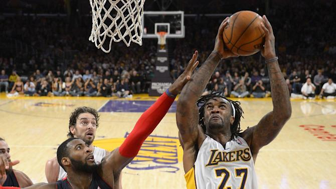 Los Angeles Lakers center Jordan Hill, right, puts up a shot as Detroit Pistons center Andre Drummond, lower left, defends while center Pau Gasol, of Spain, looks on during the second half of an NBA basketball game, Sunday, Nov. 17, 2013, in Los Angeles