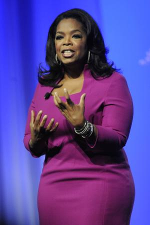 "FILE - In this Oct. 15, 2011 file photo, Oprah Winfrey speaks during The Oprah Magazine's ""O You"" event in Atlanta. Winfrey says she understands why some balked when the film academy announced it would give her an honorary Oscar for her humanitarian contributions. The 57-year-old media mogul is among three honorees receiving Oscar statuettes Saturday at the Academy of Motion Picture Arts and Sciences' third annual Governors Awards. (AP Photo/John Amis, file)"