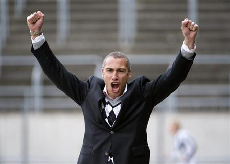 Henrik Larsson celebrates after his team Landskrona Bois scored against Degerfors in their Swedish second football league, Superettan, soccer match in Landskrona