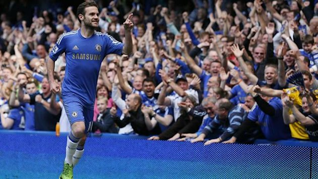 Chelsea's Juan Mata celebrates after scoring against Everton during their English Premier League match at Stamford Bridge