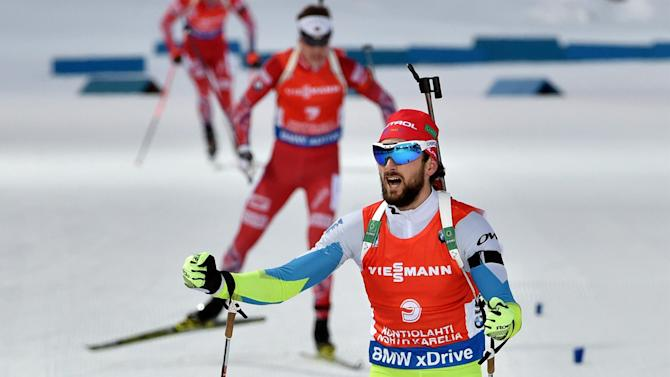 Biathlon - Jakov Fak's late rally brings curtain down on world championships