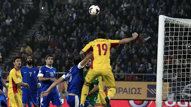 Romania's Bogdan Sorin Stancu (19) scores against Greece during their World Cup qualifying playoff first leg soccer match at the Karaiskaki stadium in the port of Piraeus, near Athens, Friday, Nov. 15, 2013