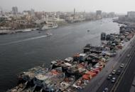 Boats and containers are seen in Dubai Creek port. Dubai's economy contracted 2.4 percent in 2009 when it rattled global markets over its debt crisis before receiving a $10-billion bailout from Abu Dhabi, its oil-rich partner in the Emirates, and reaching restructuring deals with lenders.