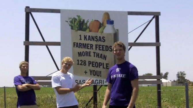 "This frame grab from video shows Assaria, Kan., brothers, from left: Kendal, Nathan and Greg Peterson in their video parody on LMAFO's ""Sexy and I Know It.""  The parody, that has gone viral on YouTube and Facebook, shows the three brothers rapping their farming mission on the family's Saline County farm. (AP Photo/Courtesy Greg Peterson)"
