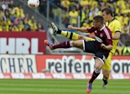 Dortmund's midfielder Ivan Perisic (R) and Nuremberg's striker Robert Mak fight for the ball during their German first division Bundesliga football match in Nuremberg, southern Germany. The match ended in a 1-1 draw