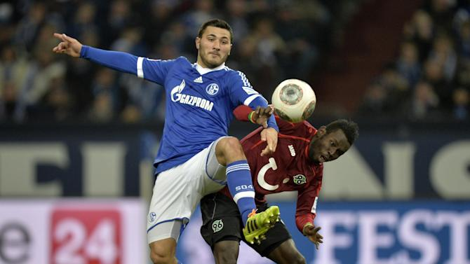 Schalke's Sead Kolasinac, left, and Hannover's Mame Diouf challenge for the ball during the German Bundesliga soccer match between FC Schalke  and SV Hannover in Gelsenkirchen,  Germany, Sunday, Feb. 9, 2014