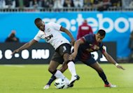 Manchester United's Patrice Evra (L) vies with Barcelona's Alexis Sanchez during the friendly football match between Barcelona FC and Manchester United at Ullevi Stadium in Gothenburg. The match ended in a 0-0 draw