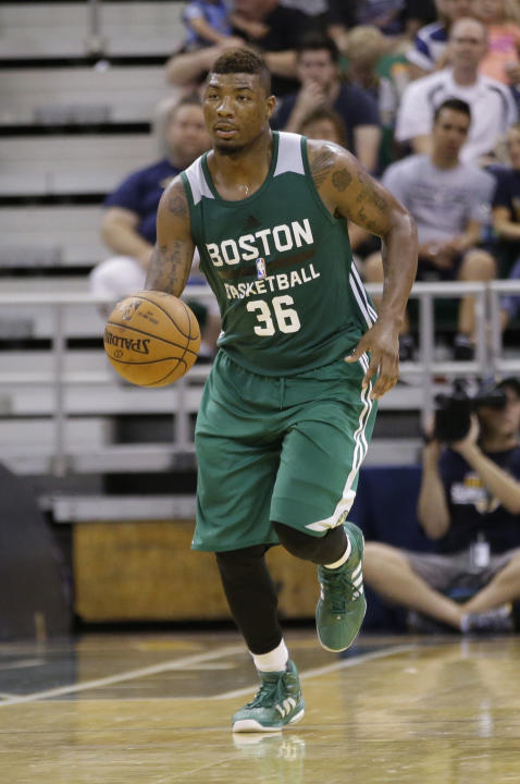 Boston Celtics' Marcus Smart brings the ball up court during the second half of an NBA summer league basketball game against the Utah Jazz Monday, July 6, 2015, in Salt Lake City.  (AP Photo/Rick