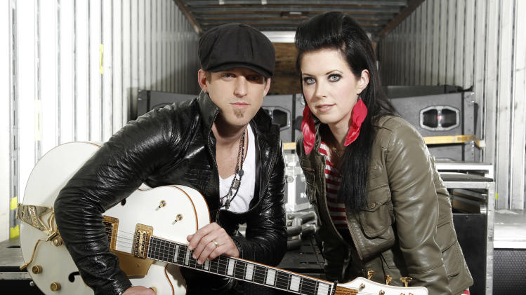 FILE - In this Oct. 27, 2011 photo, musicians Keifer Thompson, left, and Shawna Thompson, of the group Thompson Square, pose for a portrait in Los Angeles. The husband-wife team are canceling their upcoming performances after Shawna Thompson's father died Thursday, Feb. 23, 2012 in Alabama. (AP Photo/Matt Sayles, file)
