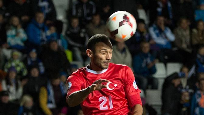 Turkey's Omer Toprak  heads the ball during a World Cup Group D qualifying soccer match between Estonia and Turkey in Tallinn, Estonia, Friday, Oct. 11, 2013