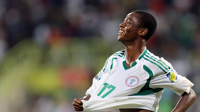 Chidera Ezeh of Nigeria celebrates after scoring a goal against Sweden during a semifinal soccer match of the World Cup U-17 at Rashid stadium in Dubai, United Arab Emirates, Tuesday, Nov. 5, 2013. (AP Photo)