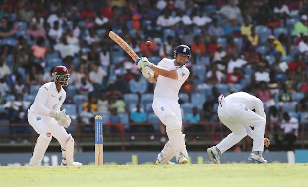 Cricket: England's Alastair Cook in action as West Indies' Denesh Ramdin looks on
