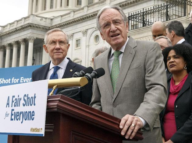 FILE - This April 2, 2014 file photo shows Senate Health, Education, Labor and Pensions Committee Chairman Sen. Tom Harkin, D-Iowa, right, accompanied by Senate Majority Leader Harry Reid of Nev., lef