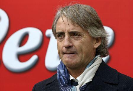 Inter Milan's coach Roberto Mancini looks on before the start of their Italian Serie A soccer match against Carpi at the San Siro stadium in Milan