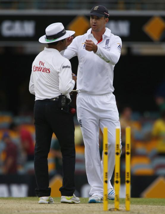 England's Pietersen shares a moment with umpire Dar of Pakistan as they walk off the field at the end of the second day's play of the first Ashes cricket test match against Australia, in Brisbane
