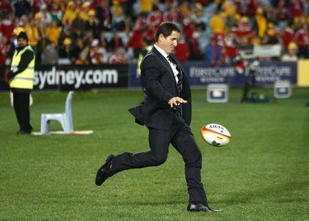 Australia Wallabies' head coach Robbie Deans kicks the ball before the start of their third and final rugby union test match between their team and the British and Irish Lions at ANZ stadium in Sydney