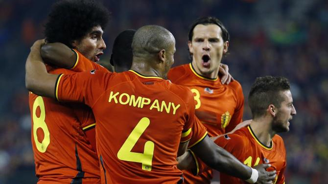 Belgium's Fellaini celebrates with teammates after scoring a goal against Ivory Coast during their international friendly match in Brussels