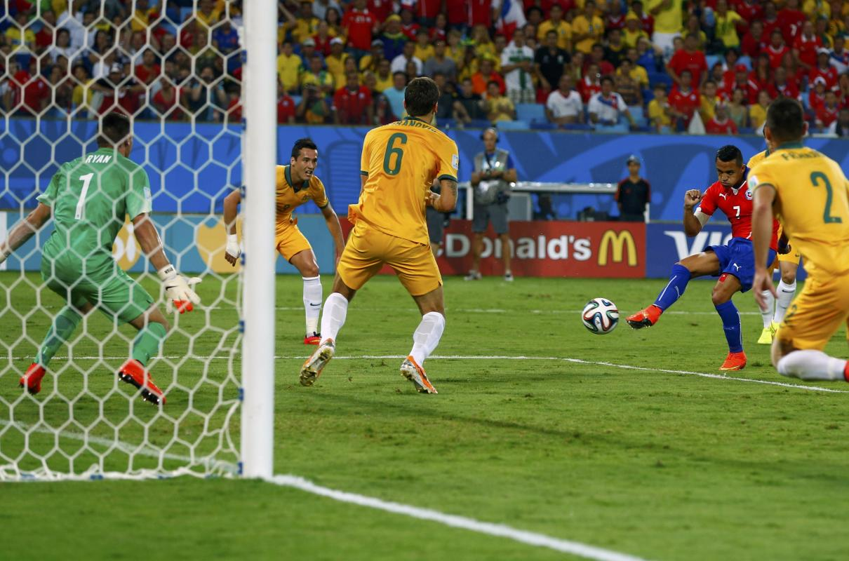 Chile's Sanchez shoots to score a goal against Australia during their 2014 World Cup Group B soccer match at the Pantanal arena in Cuiaba