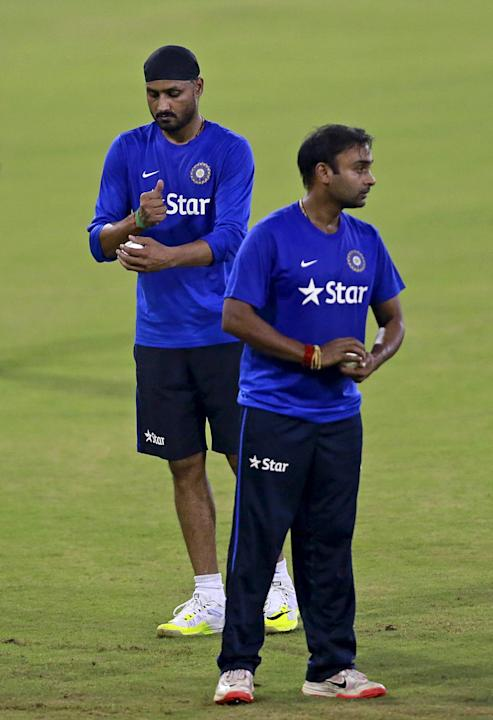 India's Singh and Mishra prepare to bowl in the nets during a practice session ahead of their second Twenty-20 cricket match against South Africa in Cuttack