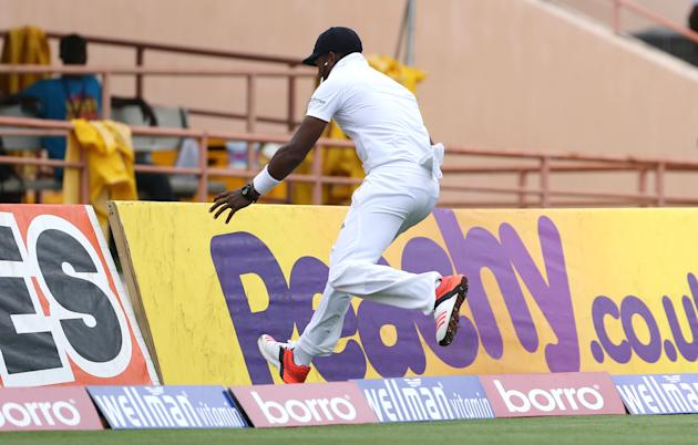 Cricket: England's Chris Jordan clashes with the advertising boards while fielding in the outfield