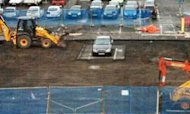 Car Park Dug Up Around Marooned Mercedes