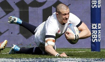 England's Mike Brown scores against Italy in their Six Nations rugby union match at the Olympic Stadium in Rome