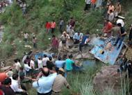 Indian rescuers at the scene after a bus fell into a sparsely populated, hilly area of Himachal Pradesh. At least 41 people were killed when a passenger bus plunged into a gorge on Saturday in a mountainous region of north India, an official told AFP