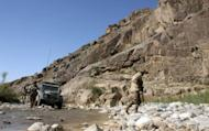 This file photo shows NATO soldiers patrolling a remote area in Afghanistan. Twin bomb blasts tore through a local market in northern Afghanistan's Baghlan province on Monday, wounding 18 people, most of them civilians, according to officials