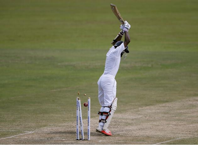 Sri Lanka's Silva is bowled out by India's Yadav during the third day of their third and final test cricket match in Colombo