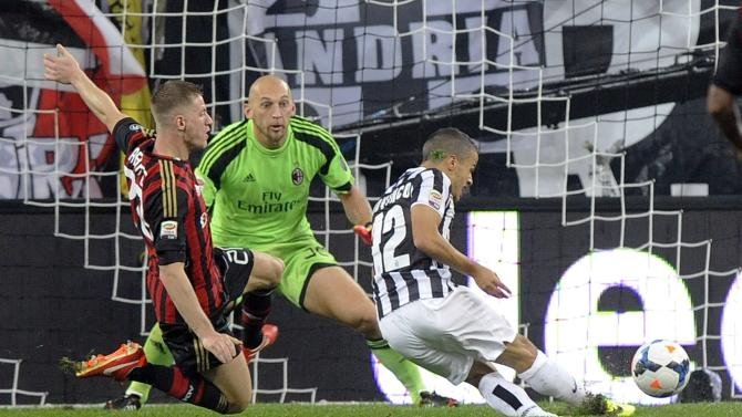 Juventus' Giovinco scores against AC Milan during their Italian Serie A soccer match in Turin