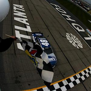 Johnson holds off Harvick to win at Atlanta