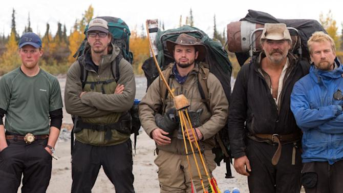 "In this 2012 photo released by National Geographic Channels and Brian Catalina Entertainment, Dallas Seavey,  Willi Prittie, Tyrell Seavey, Brent Sass, Austin Manelick, Marty Raney, Tyler Johnson and Matt Raney, from left, pose for a photo in Alaska. The eight mushers or outdoor adventurers will be featured in the latest reality show set in Alaska. ""Ultimate Survival Alaska"" premieres Sunday on NatGeoTV. (AP Photo/National Geographic Channels, Stewart Volland)"