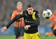 Borussia Dortmund's Robert Lewandowski in action during UEFA Champions League, Round 16, football match in Donetsk on February 13, 2013. Dortmund's chief executive officer Hans-Joachim Watzke has admitted he expects to lose the Poland striker, with Bundesliga rivals Bayern Munich favourites to sign him