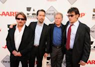"""FILE - In this Sept. 23, 2011 file image originally released by AARP, from left, Emilio Estevez, Ramon Estevez, Martin Sheen and Charlie Sheen pose at the premiere of Emilio's film, """"The Way,"""" as part of AARP's Festival For Grown Ups at the Nokia Theatre in Los Angeles. Martin Sheen admits to guilt about how his offspring were affected, in earlier years, by the alcoholism that bedeviled him and by his consuming career ambitions. If he had it to do over again he wouldn't have had four children, he says, he would have had eight: """"For how do we know ourselves but through our children?"""" (AP Photo/AARP, Doug Van Sant)"""