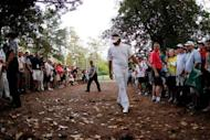 Bubba Watson of the United States looks at a shot from the rough on second sudden death playoff hole on the 10th during the final round of the 2012 Masters Tournament at Augusta National Golf Club in Augusta, Georgia
