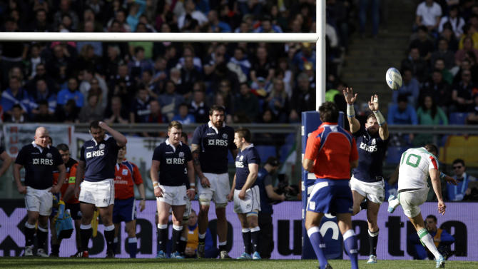 Italy's Tommaso Allan, right, scores on a free kick during a Six Nations rugby union international match between Italy and Scotland, Saturday, Feb. 22, 2014. (AP Photo/Andrew Medichini)