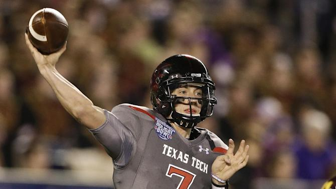 Texas Tech quarterback Davis Webb throws a pass during his record setting first half against Arizona State during  the Holiday Bowl NCAA college football football game Monday, Dec. 30, 2013, in San Diego. Webb threw four touchdown passes and 301 yards in the first half
