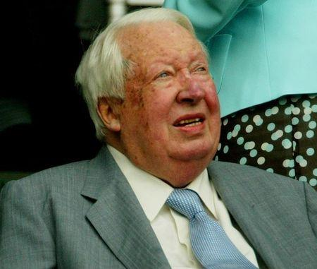 BRITAIN'S FORMER PRIME MINISTER HEATH WATCHES WOMEN'S SINGLES FINAL AT WIMBLEDON.