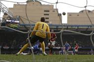 Chelsea's Demba Ba (L) scores a goal past Manchester United's Spanish goalkeeper David De Gea during the FA Cup quarter final replay football match between Chelsea and Manchester United at Stamford Bridge stadium in London, England on April 1, 2013. Chelsea won 1-0