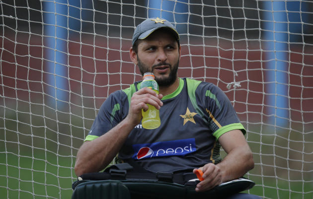 Pakistan's Shahid Afridi takes a break after batting in the nets during a training session ahead of their ICC Twenty20 Cricket World Cup match against India in Dhaka, Bangladesh, Thursday, March 2